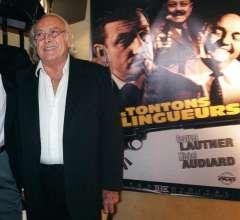 564072-le-cineaste-georges-lautner-devant-l-affiche-de-son-film-les-tontons-flingueurs-le-12-septembre-2002.jpg